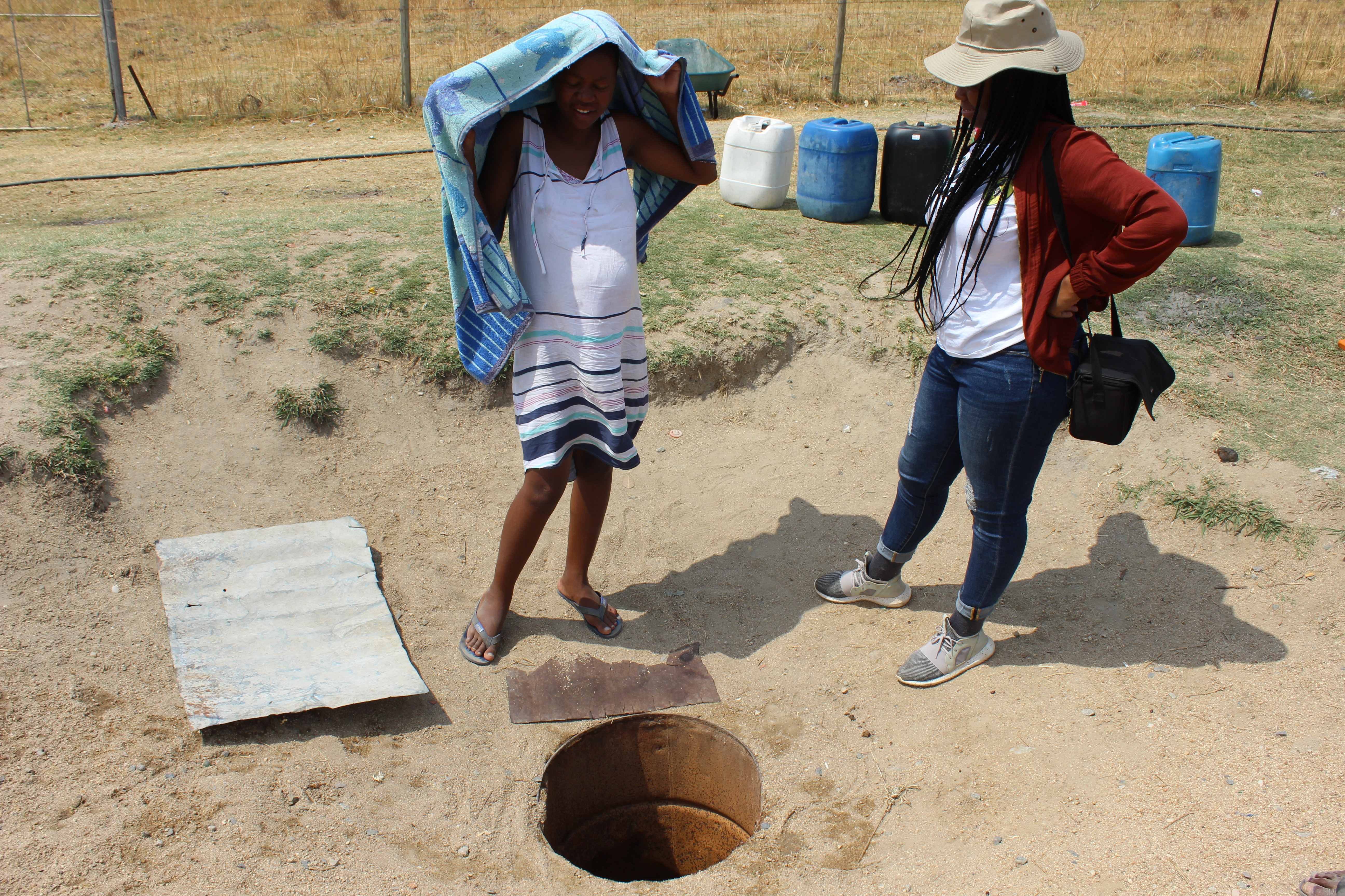 Mrs Lesedi shows AWARD the well that she collects water from on a daily basis (Photo: AWARD)